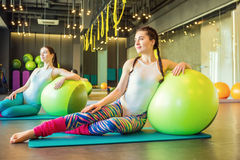 Adorable two young woman fitness class exercises. royalty free stock photos