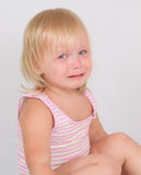 Adorable unsatisfied girl sit and cry on white Royalty Free Stock Photo