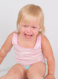 Adorable unsatisfied girl sit and cry on white Royalty Free Stock Photos