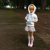 An adorable vintage TAKARA doll is standing alone at a lonely road. She`s waiting for someone who will pass by and pick her up royalty free stock image