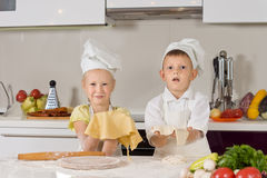 Adorable White Kids Making Foods for Snacks Stock Images
