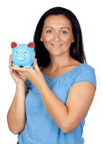 Adorable woman with a blue money-box Stock Photos