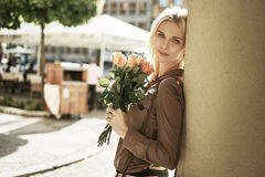 Adorable woman with a bouquet of roses Royalty Free Stock Photo