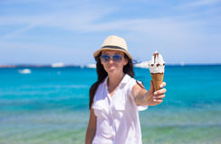 Adorable woman eating ice cream on tropical beach Royalty Free Stock Photos