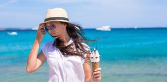 Adorable woman eating ice cream on tropical beach Stock Photography