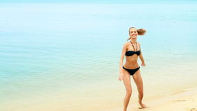 Adorable woman having fun on the beach stock footage