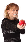 Adorable woman holding an apple Royalty Free Stock Image