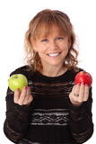 Adorable woman holding an apple Royalty Free Stock Photography