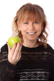 Adorable woman holding an apple Stock Photo