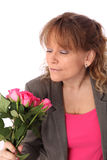 Adorable woman holding pink roses Royalty Free Stock Photography