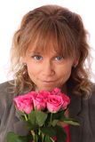 Adorable woman holding pink roses Royalty Free Stock Images