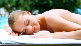 Adorable woman lying on spa bed stock video footage