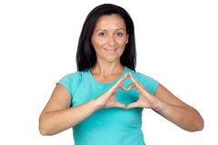 Adorable woman making a heart with the hand Stock Image