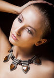 Adorable Woman with Metallic Necklace and Amber. Natural Makeup Royalty Free Stock Photo
