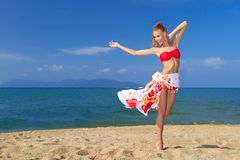 Adorable woman standing at the tropical beach Stock Photography
