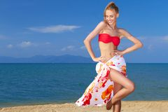 Adorable woman standing at the tropical beach. Wearing colorful scarf Royalty Free Stock Photography