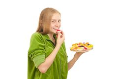 Adorable woman tasting fruits and berries Stock Image