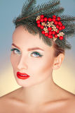 Adorable woman with wreath on head and healthy skin looking at c Stock Images