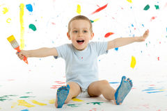 Adorable 3 year old boy child creatively stains on the wall. Stock Images