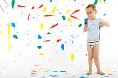 Adorable 3 year old boy child creatively stains on the wall. Stock Photo