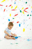 Adorable 3 year old boy child creatively stains on the wall. Royalty Free Stock Photo
