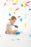 Adorable 3 year old boy child creatively stains on the wall. Royalty Free Stock Photos