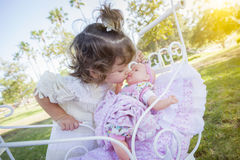 Adorable Young Baby Girl Playing with Baby Doll and Carriage Stock Photos