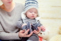 Adorable young baby in a winter outfit Royalty Free Stock Image
