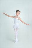Adorable young ballerina poses on camera Royalty Free Stock Photography