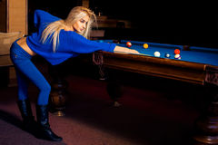 Adorable young beautiful blonde concentrated on pool billiard ga Royalty Free Stock Image