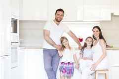 Adorable young big family embracing on kitchen Stock Photos
