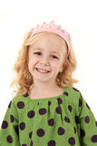 Adorable young blond girl wearing a pink tiara Royalty Free Stock Photo