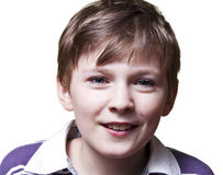 Adorable young boy. Studio shot of a adorable young boy smiling isolated on withe background Royalty Free Stock Images