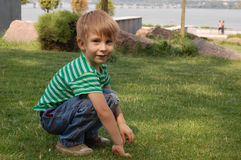 Adorable young boy in city park Royalty Free Stock Photography