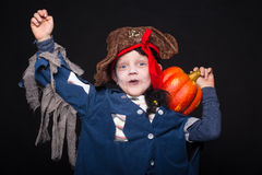 Adorable young boy dressed in a pirate outfit, playing trick or treat for Halloween Stock Photo
