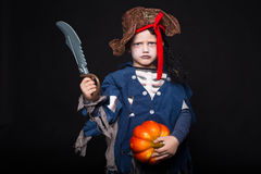 Adorable young boy dressed in a pirate outfit, playing trick or treat for Halloween Royalty Free Stock Photography