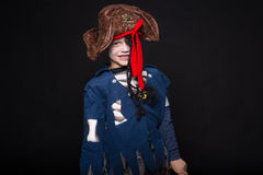 Adorable young boy dressed in a pirate outfit, playing trick or treat for Halloween Royalty Free Stock Photo
