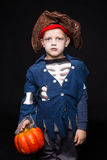 Adorable young boy dressed in a pirate outfit, playing trick or treat for HalloweenLittle boy in a pirate costume for Halloween on Stock Images