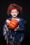 Adorable young boy dressed in a pirate outfit, playing trick or treat for HalloweenLittle boy in a pirate costume for Halloween on Stock Photo