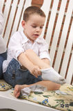 Adorable Young Boy Getting Socks On Stock Image
