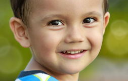 Adorable young boy looking at camera Royalty Free Stock Image