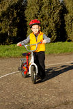 Adorable young boy posing with his bicycle Stock Image