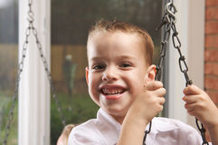 Adorable Young Boy Smiles Stock Image