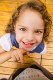 Adorable young brunette girl standing on wooden Royalty Free Stock Images