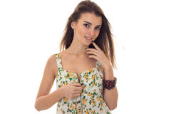 Adorable young brunette woman take off her sarafan with floral pattern and seduce on camera isolated on white background Stock Photos