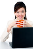 Adorable young businesswoman holding coffee cup Stock Photo