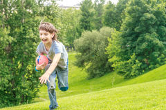 Adorable young child boy laying on the grass in the park Royalty Free Stock Photos