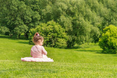 Adorable young child girl in the park. Royalty Free Stock Photos