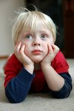 Adorable Young Child Laying on Living Room Floor Royalty Free Stock Photo