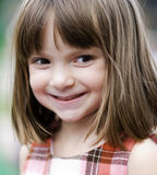 Adorable young child playing outside. Portrait of an adorable young child playing outside stock images